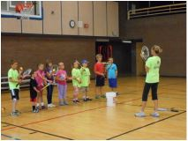 youth tennis players learning from instructor