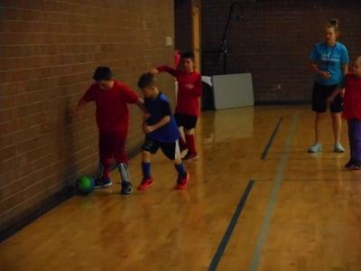 youth playing indoor soccer 3